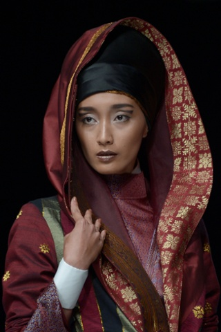 This striking portrait is of a model wearing an outfit made from one of Indonesia's traditional woven fabrics from Riau province, designed by Deden Siswanto during Jakarta fashion week.