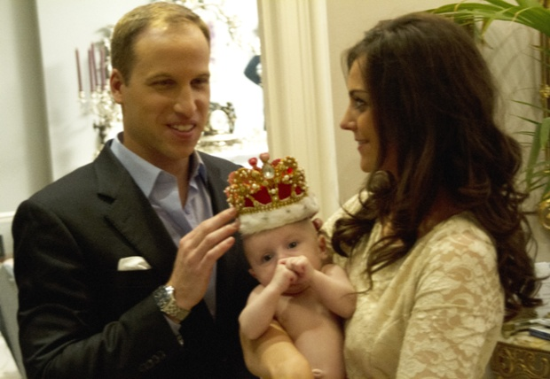 Who wears the crown? Little Prince George tries it for size.