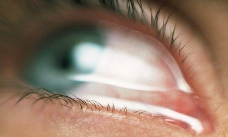 A tear-filled green eye