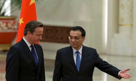 Li Keqiang welcomes David Cameron to China during a ceremony at the Great Hall of the People in Beijing.
