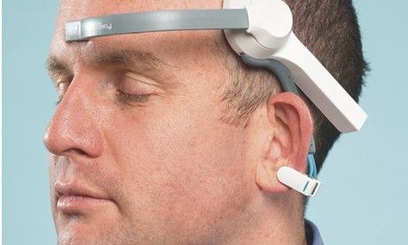 Oliver Burkeman wearing a NeuroSky MindWave headset