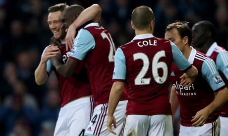 Carlton Cole is congratulated after scoring.