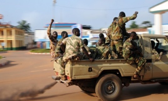 Soldiers patrol the streets of Bangui as blasts from heavy weapons rocked several districts of the Central African capital this morning. The UN Security Council was set to vote today on a measure authorising thousands of African and French troops to end troubles in the Central African Republic.