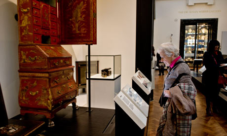 woman looking at an exhibit at the V&A museum