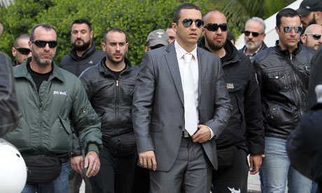 Ilias Kasidiaris, Golden Dawn MP, leaves court in Athens 4/3/13