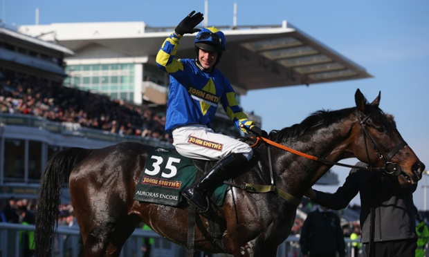 66-1 shot Auroras Encore ridden by Ryan Mania celebrates winning the Grand National at Aintree.
