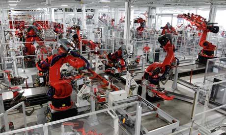 Robots assembling Tesla sports cars in California