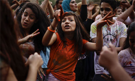 Egyptian girls dance at a festival