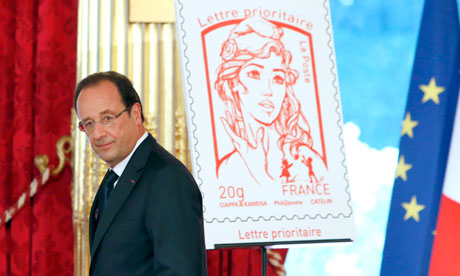 Francois Hollande at the unveiling of the new Marianne stamp. Photograph: Francois Mori/AFP/Getty Images