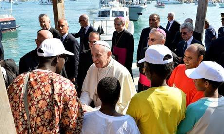 Pope Francis meets a group of immigrants at the pier in Lampedusa, Italy
