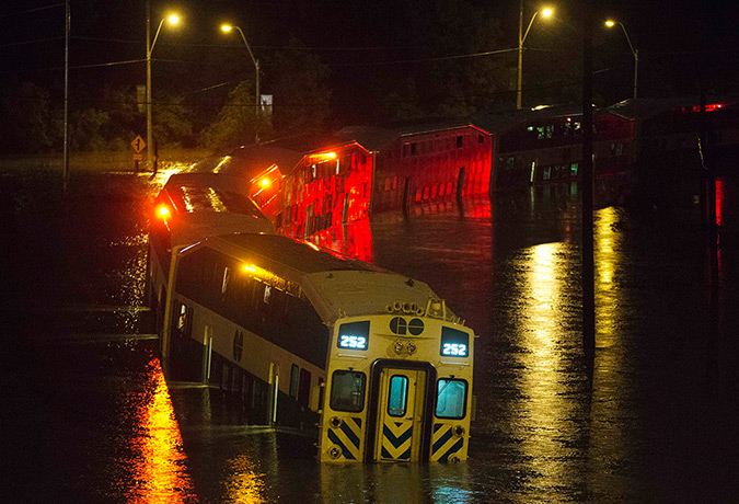 Canada floods: A Go Train with passengers waiting to be rescued stuck in flood waters