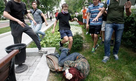 Youths kick gay rights activist during protest