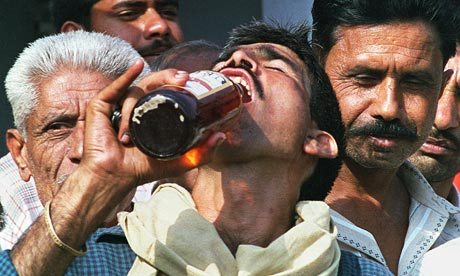 An Indian man in Faridabad drinks beer