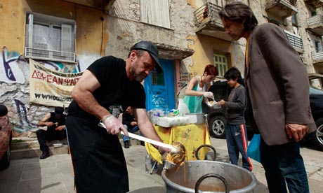 Constantinos Polychronopoulos ladels out food at a soup kitchen in Athens