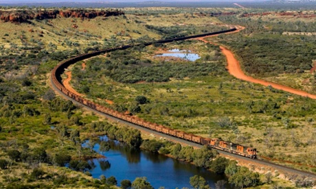 A train loaded with iron ore from a BHP Biliton mine makes its way through West Australia's Pilbara region in this undated handout photograph obtained August 12, 2009. BHP Billiton Ltd, the world's largest miner, reported a 30 percent slide in annual profit excluding writedowns, its first fall in seven years, pummelled by a slump in metals prices and demand.  REUTERS/BHP Biliton/Handout (AUSTRALIA BUSINESS ENVIRONMENT) FOR EDITORIAL USE ONLY. NOT FOR SALE FOR MARKETING OR ADVERTISING CAMPAIGNS :rel:d:bm:GF2E58C0HJ801