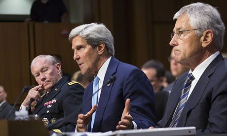 US secretary of state John Kerry, flanked by General Martin Dempsey and Chuck Hagel