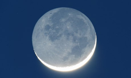 Waxing crescent moon with earthshine reflected from 'dark side'