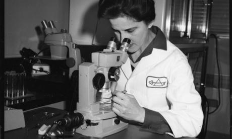 Biologist Beatrice Mintz (b. 1921) with microscope