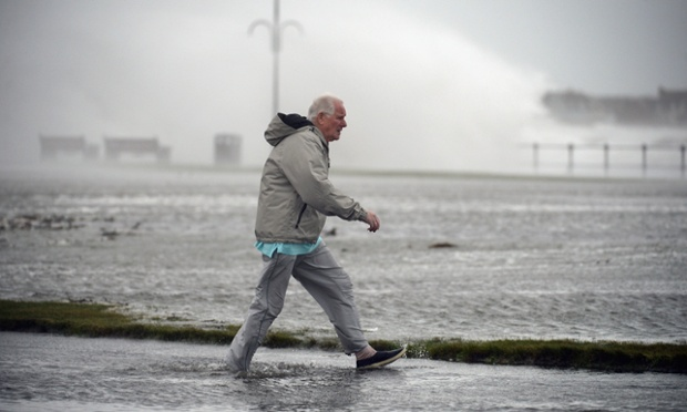 Waves break over Saltcoats esplanade in Saltcoats, Scotland. Gale force winds and an expected tidal surge are set to cause widespread flooding in coastal areas of Scotland.