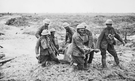 Stretcher bearers carry a wounded man to safety near Boesinghe on 1 August 1917 during the third battle of Ypres. Photograph: IWM/Getty Images