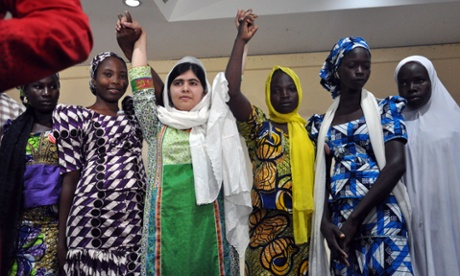 Malala Yousafzai poses with five Nigerian girls, who escaped after being abducted from their Chibok school by Boko Haram.  (LtoR) Rebecca Ishaku, Kanna Bitrus, Hauwa John, Hauwa Musa and Hawa Alhl'ama