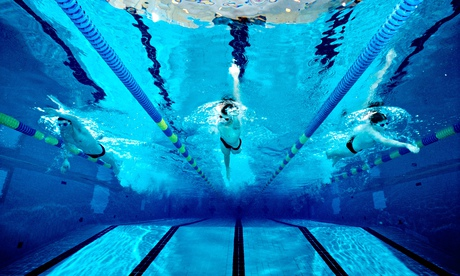 Underwater photograph of a boys high school swim team practicing in an Olympic size swimming pool.