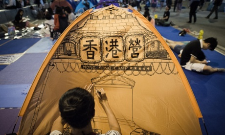 A protestor drawing on their tent.