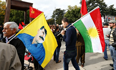 Demonstrators hold flags outside the United Nations European headquarters in Geneva