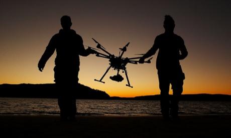 Drone operator Ken Butti and Camera operator Robbie Josephsen carry a custom built DJI s1000 Drone on Sydney's Palm Beah, Australia