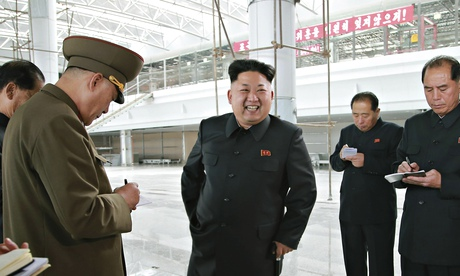 North Korean leader Kim Jong Un surrounded by officials taking notes