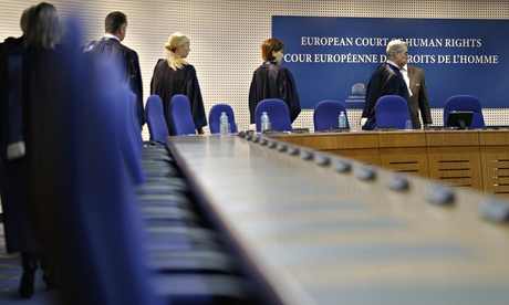 Judges of the European court of human rights enter the hearing room of the court in Strasbourg