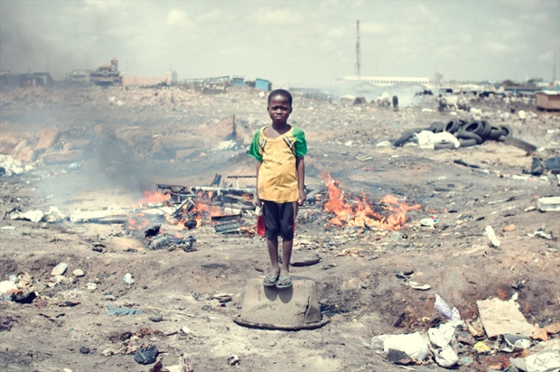 Kwabena Labobe, 10. His parents are not able to send him to school and forbid him to burn e-waste.