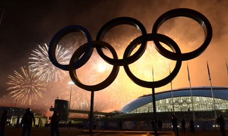 Fireworks explode around the Fisht Olympic Stadium at the end of the Closing Ceremony of the Sochi Winter Olympics.