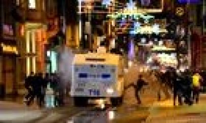 Protesters attack a Turkish police van following the funeral of a teenager
