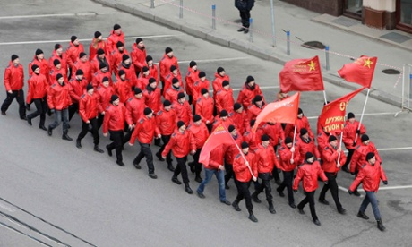People march in formation as they participate in the