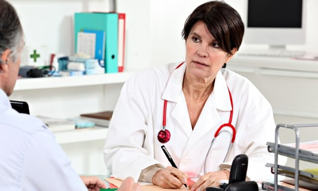 A doctors consults with a patient