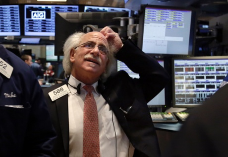 Trader Peter Tuchman works on the floor of the New York Stock Exchange, Monday, March 3, 2014.
