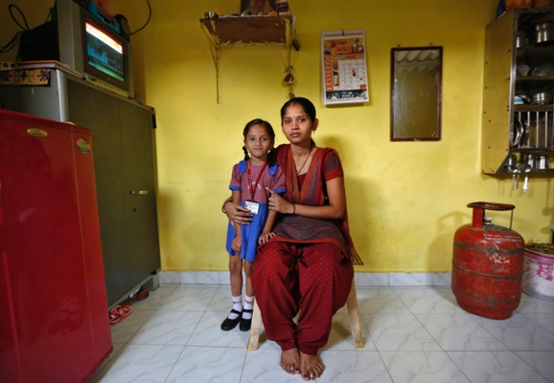 Sulochna Mohan Sawant, 23, poses with her five-year-old daughter Shamika Sawant inside their home in Mumbai. Sulochna, who works as a maid, wanted to become a doctor when she was a child., but could only study until the age of 14. Sulochna wants her daughter to become a teacher, Shamika also wants to become a teacher.
