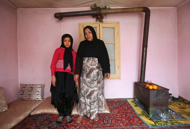 Noor Zia, 40, poses with her daughter Saba Ahmadi, 11, at their home in Kabul, Afghanistan. Noor, who is a teacher, studied until she was 28. Her ambition was to become a doctor, but she couldn't afford the fees. She hopes her daughter will become a well-known, highly skilled doctor. Saba wants to go to university, and would like to become a renowned lawyer.