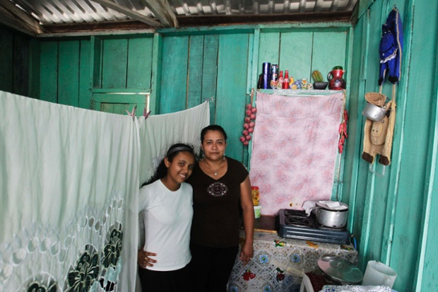 Susana Maria Cardona, 33, and her daughter Alejandra Ruby Cardona, 12, pose for a photograph inside their home in Tegucigalpa, Honduras. Susana Maria, who is a housewife, finished school at 17. Her ambition was to become a lawyer. She hopes that her daughter will become a doctor. Alejandra Ruby will finish education in 11 years and hopes to be an agronomist.
