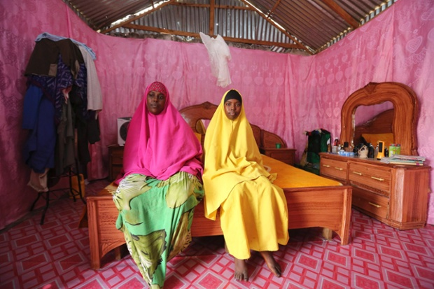 Saciido Sheik Yacquub, 34, poses for a picture with her daughter Faadumo Subeer Mohamed, 13, at their home in Hodan district IDP camp in Mogadishu. Saciido, who runs a small business, wanted to be a business woman when she was a child. She studied until she was 20. She hopes that Faadumo will become a doctor. Faadumo will finish school in 2017 and hopes to be a doctor when she grows up.