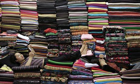Women lie on coloured cloth