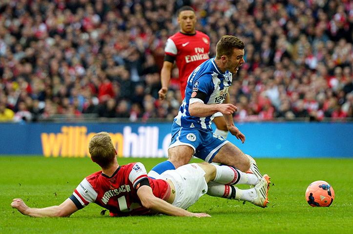 FA Cup semi: Per Mertesacker brings down Callum McManaman