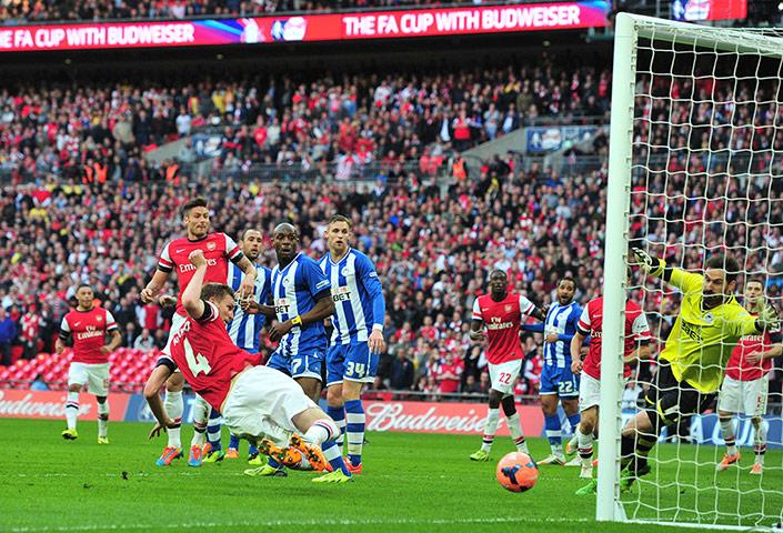 FA Cup semi: Arsenal's Per Mertesacker scores