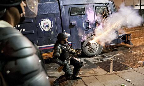 Venezuelan police clash with demonstrators in Caracas