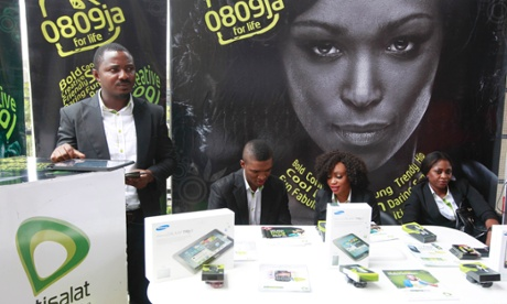 Staff of Etisalat Nigeria wait for customers during the launch of mobile number portability in Lagos, Nigeria