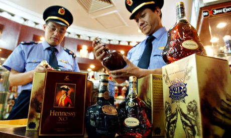 Chinese confiscate fake Remy Martin and Hennessy whiskey.