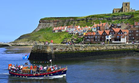 A boat entering Whitby harbour.