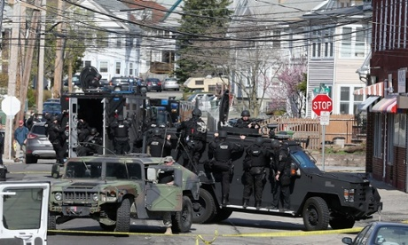 Members of a Swat team search for 19-year-old bombing suspect Dzhokhar Tsarnaev on April 19, 2013 in Watertown, Massachusetts