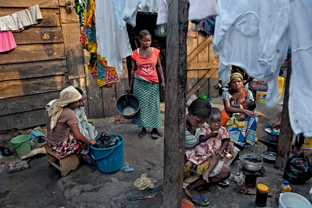 The Kayayo are girls in Ghana who travel to cities to work as market porters. They live communally,  often near or on top of the city dump. Sharifa Monaro, (centre), aged 23, works long hours for as little as 50 cents a day.